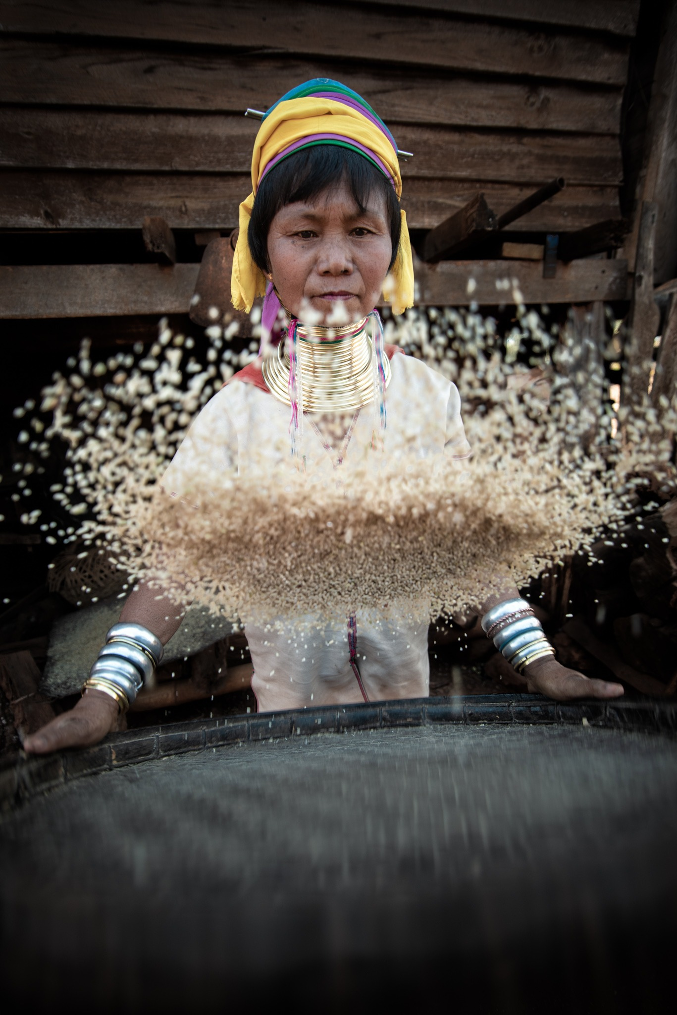 Kaynam woman cleanign rice